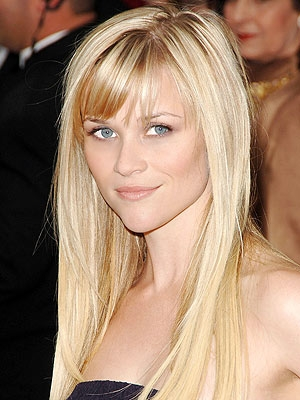 Heart shaped face. Wispy side bangs and layers look best. the layers make